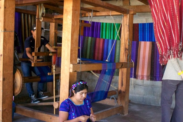 Weaving by loom and by hand at a studio in San Antonio, Guatemala
