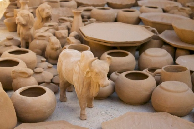 Some freshly fired clay pieces, including pots and a bull