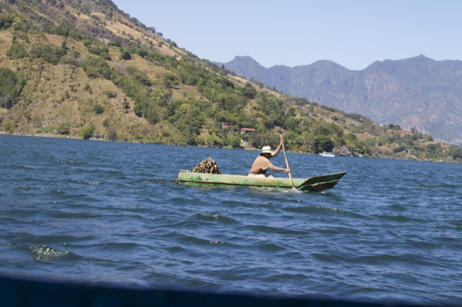 A fisherman in a dugout canoe on Lake Atitlán near Santiago, Guatemala.