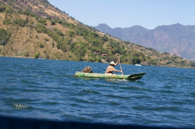 A fisherman in a dugout canoe on Lake Atitlán near Santiago, Guatemala.