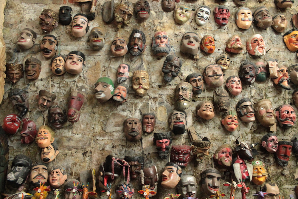 Wall of Masks hanging at a store called Nim Po't in Antingua, Guatemala