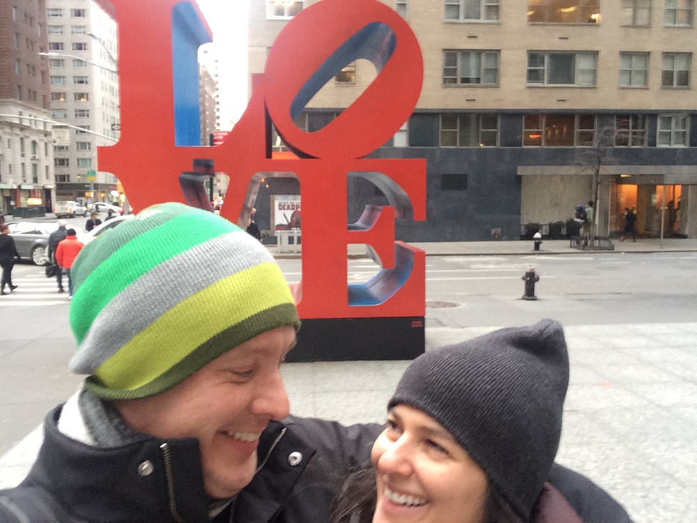 """Michael and Deborah in front of Robert Indiana's """"Love"""" sculpture at Sixth Avenue and 55th Street in Manhattan"""