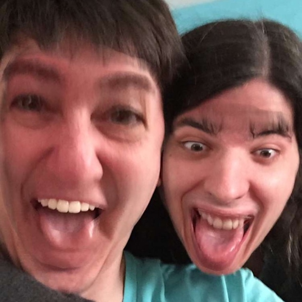 Deborah and Max swap their faces in an image using the Snapchat app