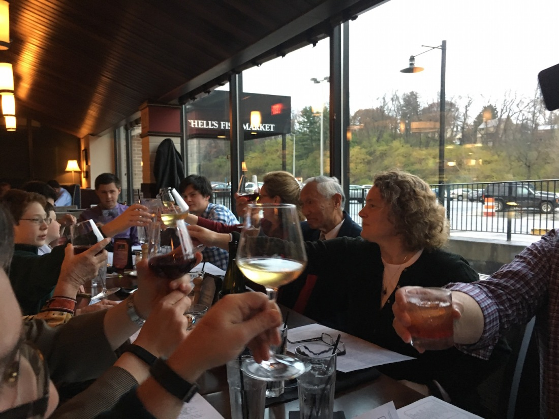 Glasses raised in a toast with Janairo family at Mitchell's Fish Market at the Galleria in Mount Lebanon, Pennsylvania