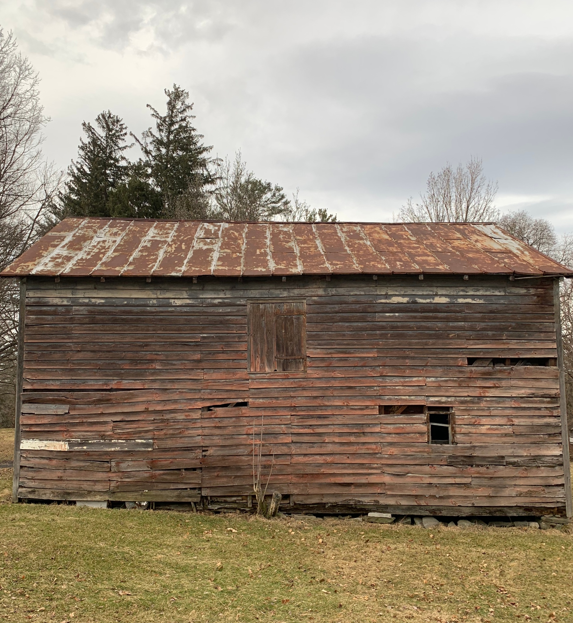 Old barn with rotting  wood siding